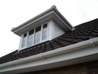 An example of replacement UPVC cladding and barge boards on a dormer window